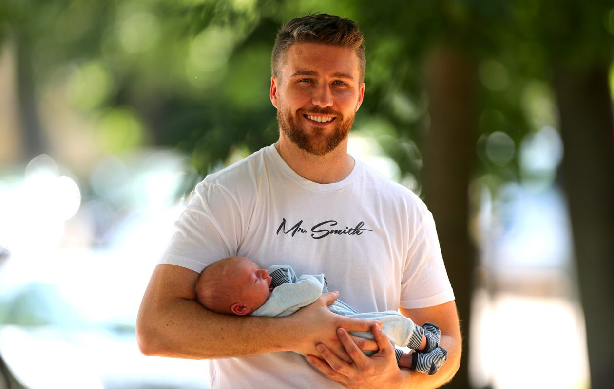 Jeremy O'Brien, at his home on Ashland Avenue, with his newborn son, Otis. (John Hickey/Buffalo News)