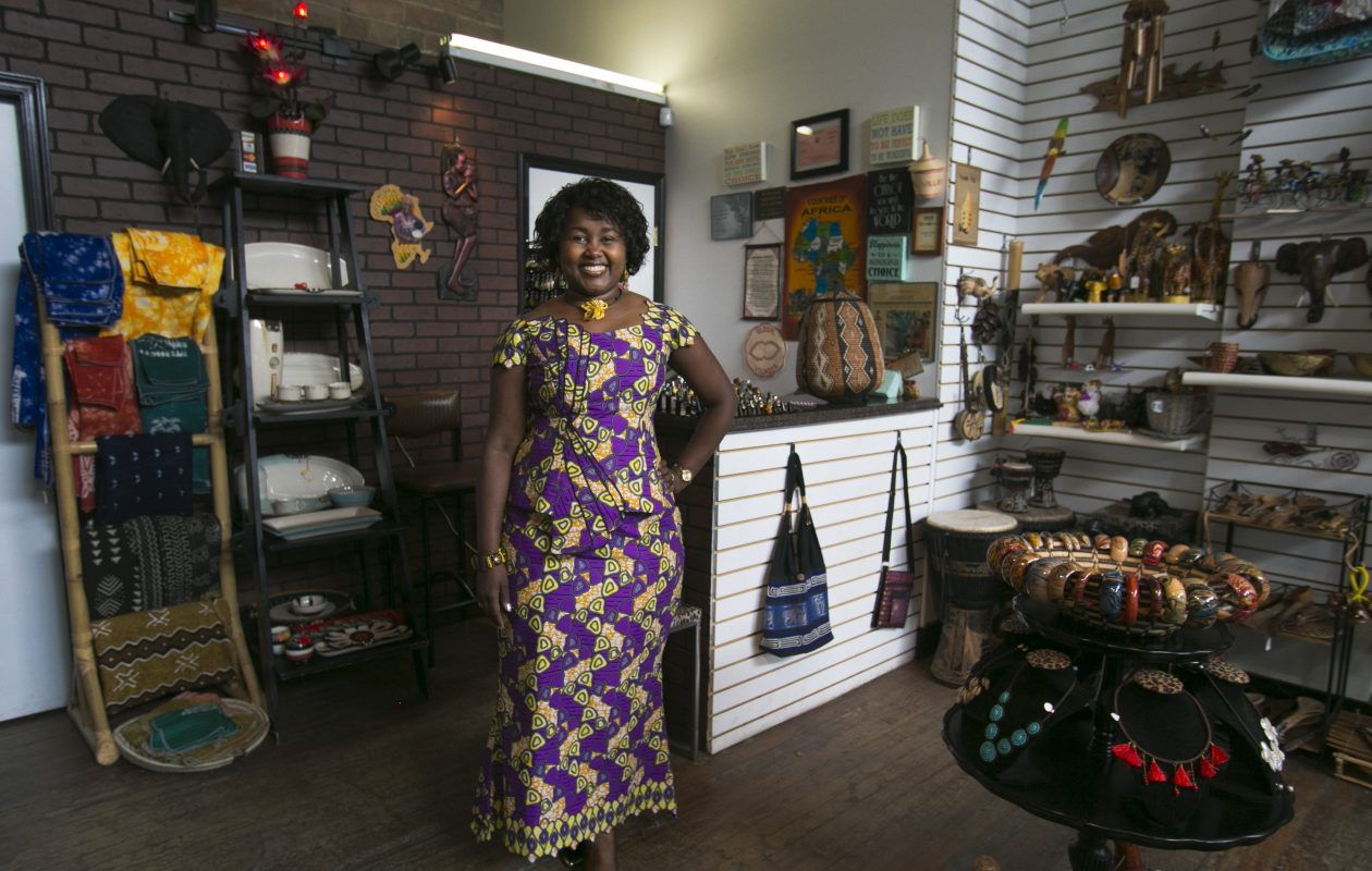 Louise Sano, owner of Global Villages and Global Chic on Grant Street, wears a favorite dress made from African wax print fabric. (Shuran Huang/Buffalo News)