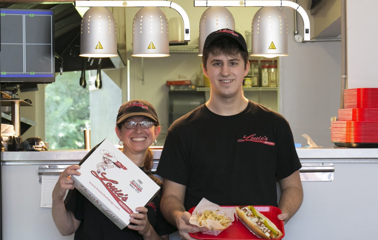 Elaine Baker and her son Jack stand inside Louie's Foot Long Hot Dogs. (Shuran Huang/Buffalo News)