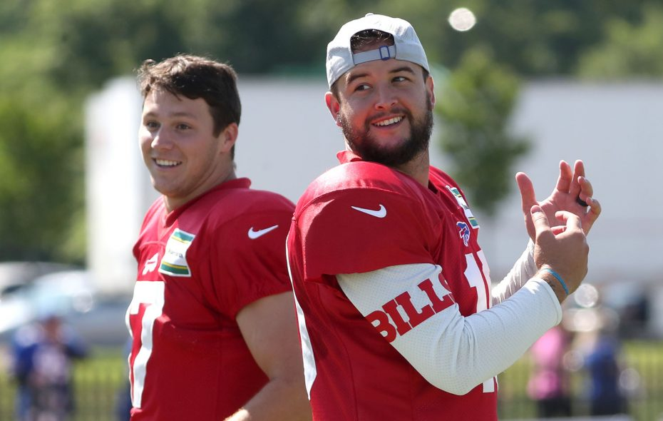 AJ McCarron, right, and rookie Josh Allen will be under the spotlight Thursday for the Buffalo Bills. (James P. McCoy/News file photo)