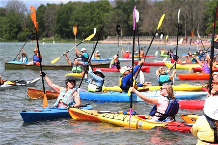 Hundreds of kayakers take to the waters by Beaver Island State Park
