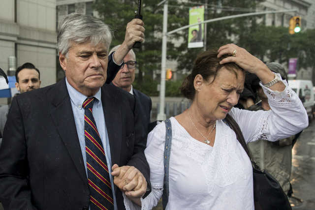 Dean Skelos, the former majority leader of the New York State Senate, and his wife, Gail, exit federal court Tuesday in New York City. Skelos and his son, Adam, were found guilty on all counts in a corruption retrial. (Getty Images)