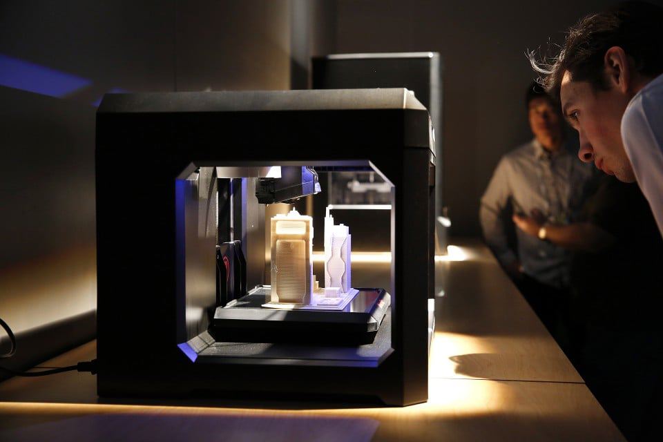 A 3-D printer can create a physical object out of a computer model. (Bloomberg photo by Patrick T. Fallon)