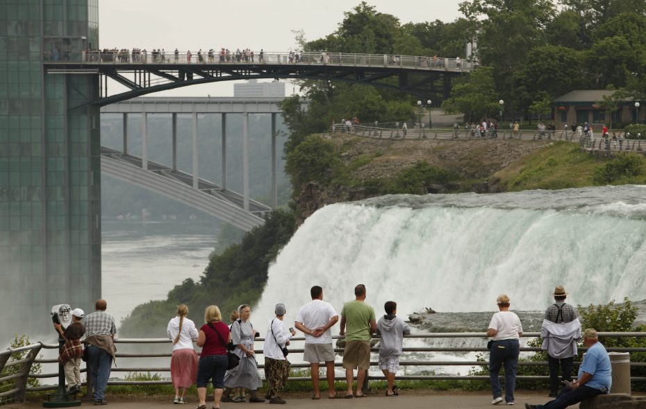 Tourists take in the sights on Goat Island at Niagara Falls State Park.  (Derek Gee / News file photo)