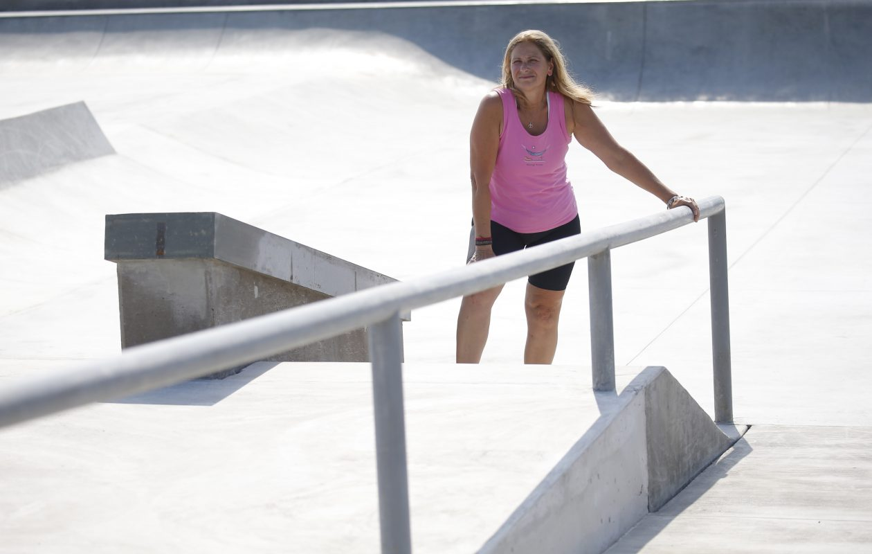 Tammy Schueler stands in the middle of the Alix Rice Peace Park, set to open on Aug. 4. Schueler and other volunteers spent years creating a skate park in memory of Alexandria 'Alix' Rice, Schueler's daughter, who was killed by a drunken driver in 2011. (Robert Kirkham/Buffalo News)