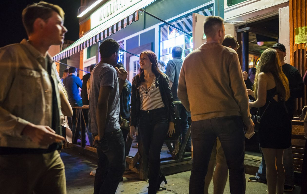 Revelers come and go at Mulligan's Brick Bar on Allen Street early Saturday morning, Oct. 21, 2017.  (Derek Gee/News file photo)