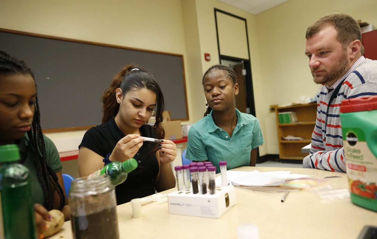 Hamlin Park Academy students, from left, Shaniylah Welch, 13, Gabriella Melendez, 12, and Toriana Cornwell, 13, worked with teacher  Andrew Franz, right, to send potato seedlings to the International Space Station in 2016. (Derek Gee/News file photo)