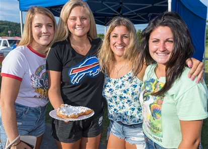 Smiles hits Wellsville in Allegany County for the first time, as the Great Balloon Rally kicked off three days of hot-air balloons and carnival-like festivities at Island Park on Friday, July 20, 2018. The afterglow balloons, scheduled for 9 p.m., were among the better visuals.