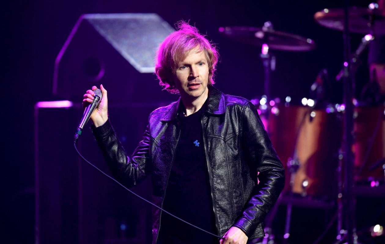 Beck, seen here performing recently at the Dolby Theatre in Hollywood, stuck around through the rain to finish his set outside the Albright-Knox Art Gallery. (Getty Images)