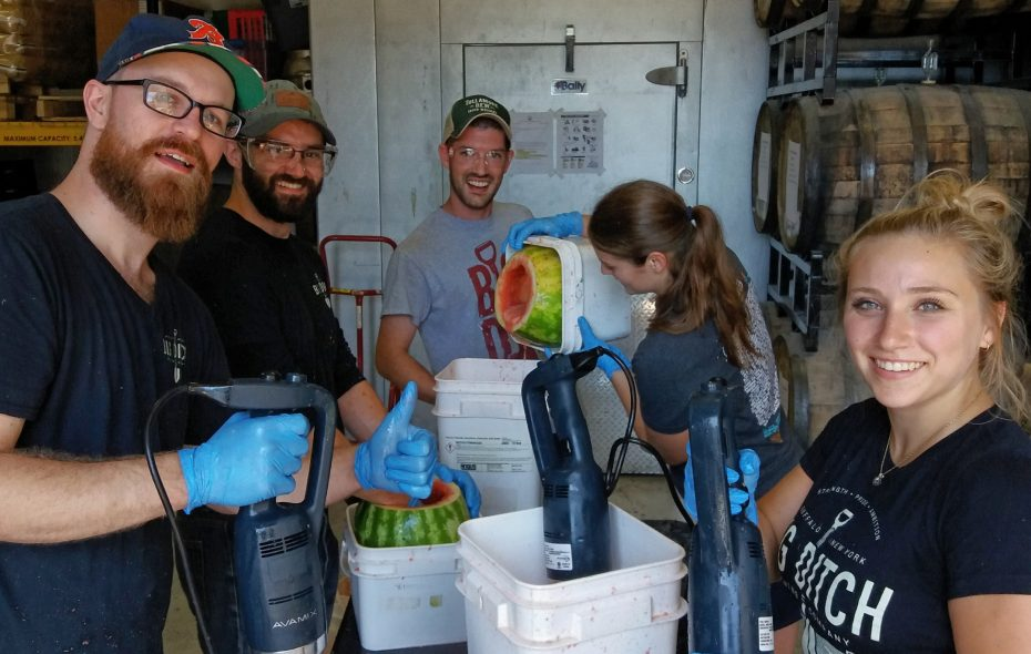The crew at Big Ditch juices watermelons for its Watermelon Hefeweizen. (via Big Ditch