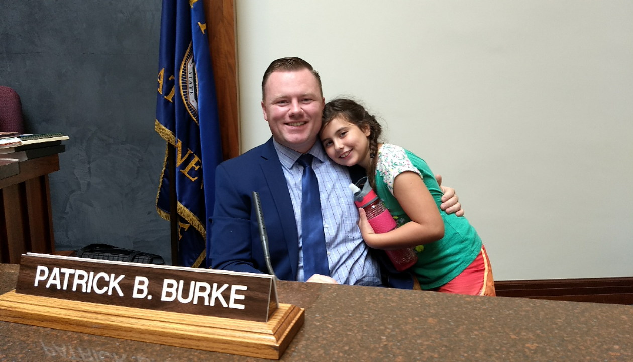 Patrick Burke sits with his daughter, Maggie, 9, in County Legislature Chambers after being subjected to a snide remark from her younger brother at a news conference Tuesday. (Sandra Tan/Buffalo News)