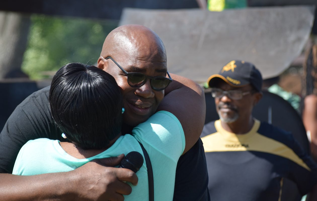 Murray Holman, executive director of Buffalo's Stop the Violence Coalition, hugs his mother-in-law, Florene Washington, 66, of Buffalo, during a picnic in Martin Luther King Jr. Park on Sunday. (Sam Ogozalek/Buffalo News)