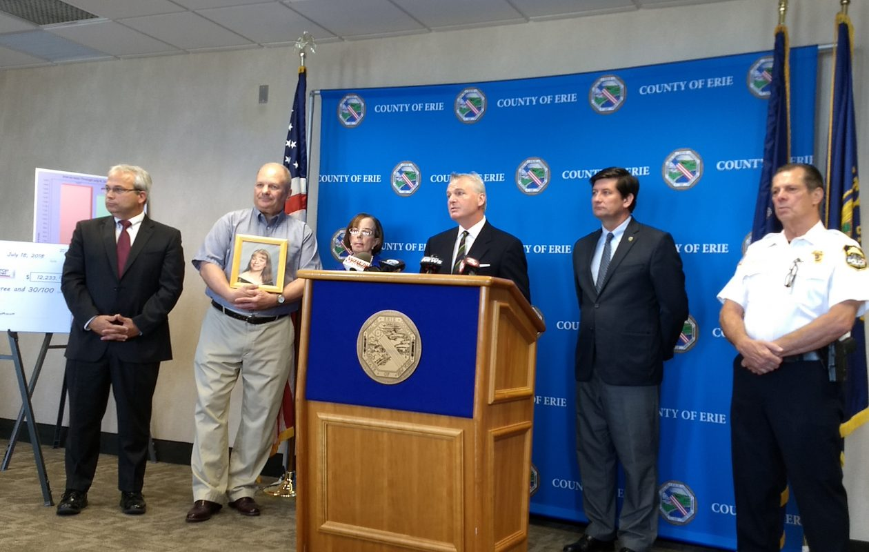 Erie County officials announce a reduction in DWI arrests, along with the parents of a child that was killed by a drunken driver. (Sandra Tan/Buffalo News)