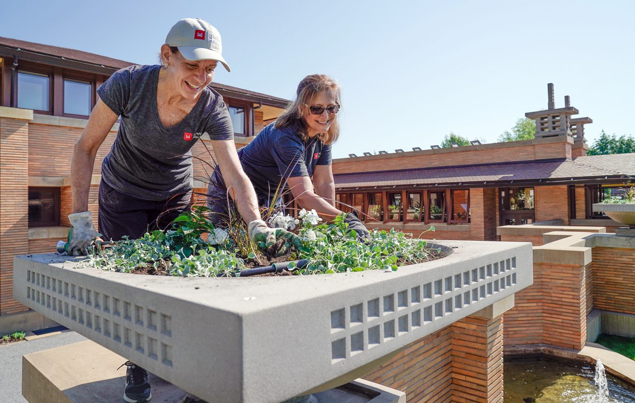 Volunteers help maintain the grounds of the Martin House. (Dave Jarosz)