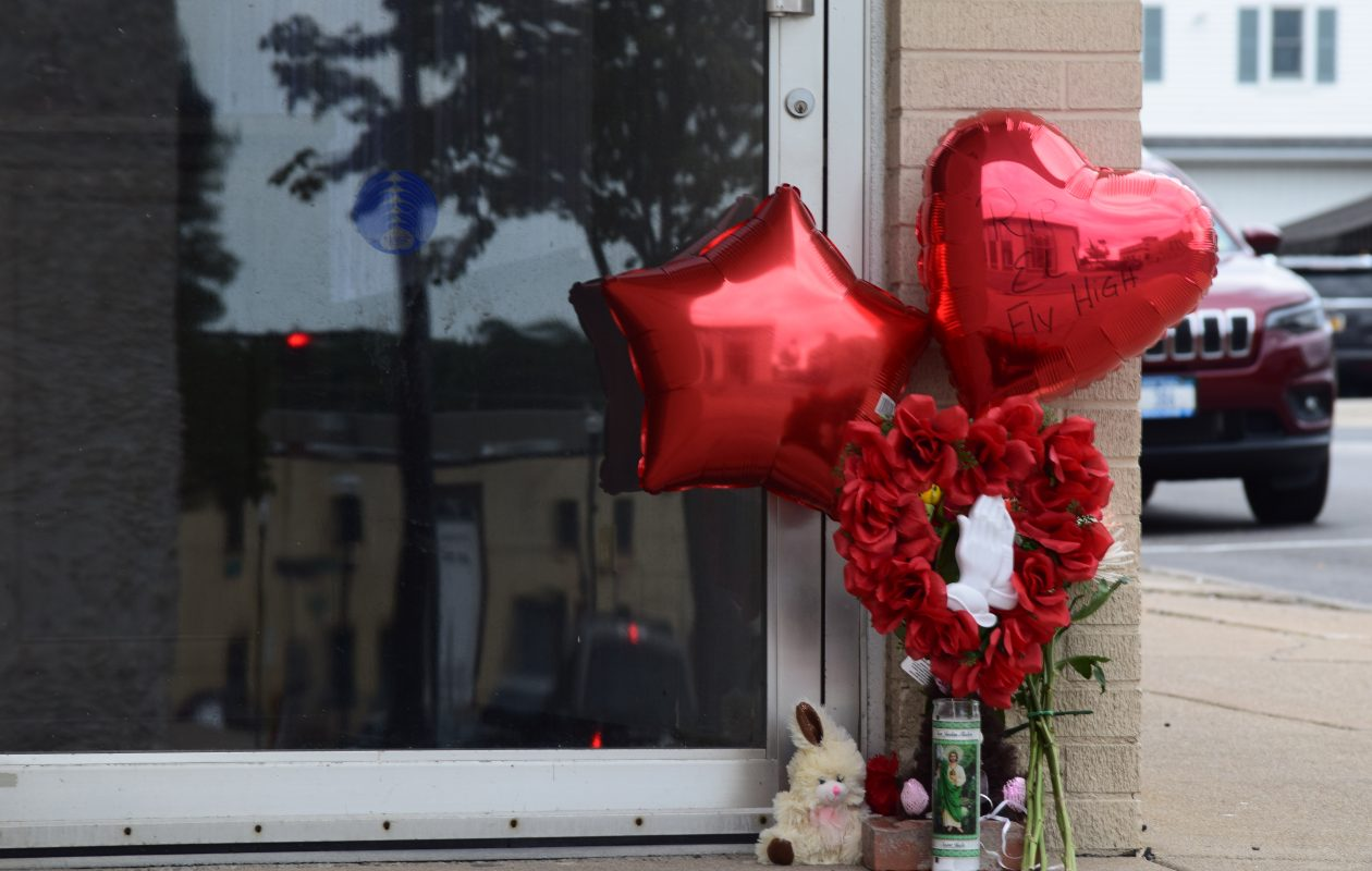 A memorial was built at Pine Street and Heritage Court in Lockport on Monday, July 23, 2018 in honor of 16-year-old Elijah Wedington, who was fatally stabbed there late Sunday. (Sam Ogozalek/Buffalo News)