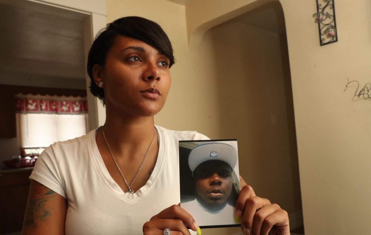 Former Buffalo Police Officer Felisha Kenyon holds a photo of her brother, Demonety Davis, who was shot to death on May 27, 2018, in Buffalo. Kenyon was fired by the police department on June 14. Her ex-husband, Officer Christopher Bridgett, was shot July 22 while off-duty. (Sharon Cantillon/Buffalo News)