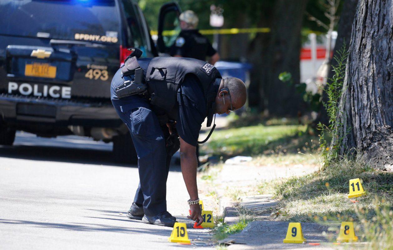 A Buffalo police officer works at the scene of a double-shooting on Lisbon Avenue. (Mark Mulville/Buffalo News)