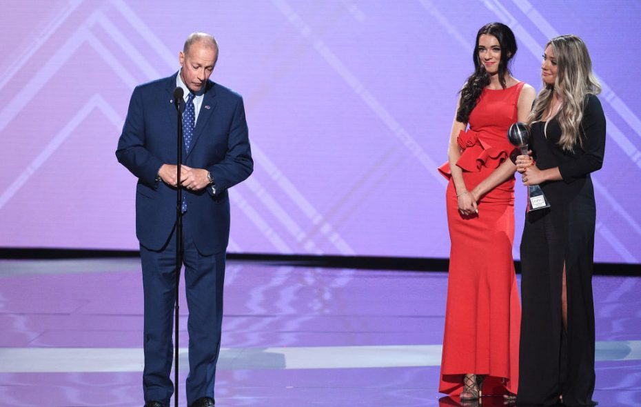 Jim Kelly accepts the Jimmy V Award onstage, alongside daughters Camryn Kelly and Erin Kelly, at the 2018 ESPYS in Los Angeles Wednesday.  (Getty Images)