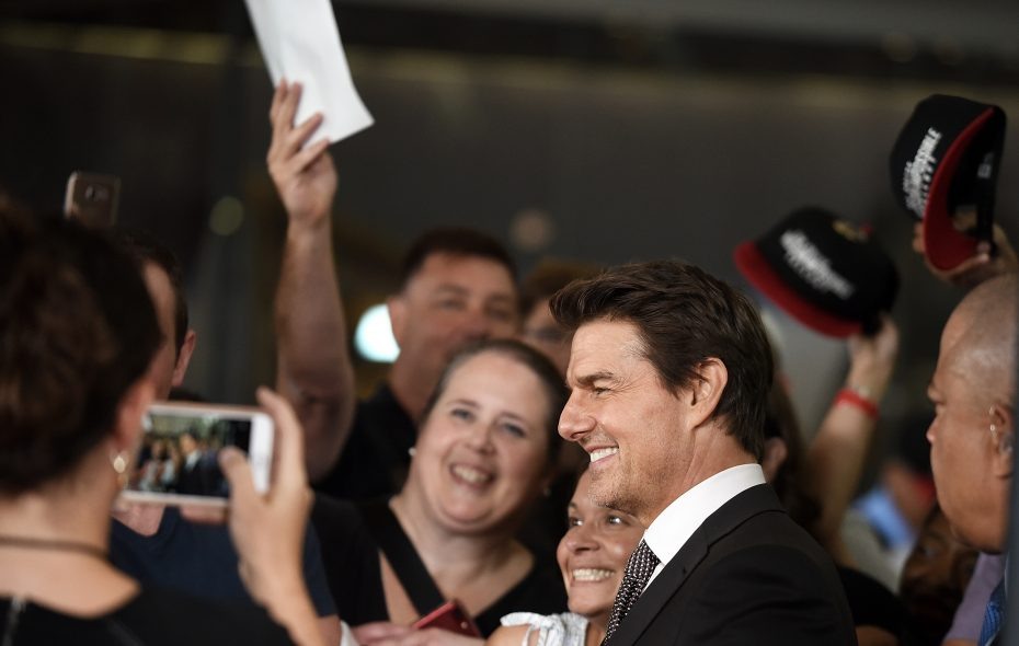 """Tom Cruise, who just turned 56,  greets fans at the U.S. premiere of """"Mission: Impossible - Fallout"""" at Smithsonian's National Air and Space Museum on July 22, 2018 in Washington, DC.  (Photo by Shannon Finney/Getty Images)"""