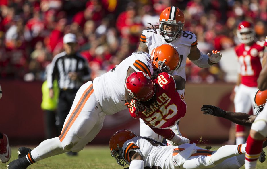 Running back Jamaal Charles #25 of the Kansas City Chiefs is hit by defensive tackle John Hughes #93 of the Cleveland Browns during the game at Arrowhead Stadium on October 27, 2013 in Kansas City, Missouri. (Photo by David Welker/Getty Images)