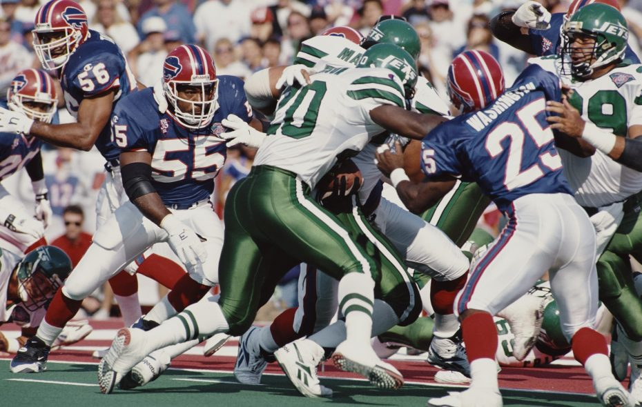 Mark Maddox (55, on left), a Buffalo Bills linebacker, prepares to hit Richie Anderson, a fullback for the New York Jets, during their American Football Conference game in 1994 at what was then called Rich Stadium, now New Era Field, in Orchard Park. The Jets won the game, 23-3.  (Photo by Jim Rick Stewart/Allsport/Getty Images)