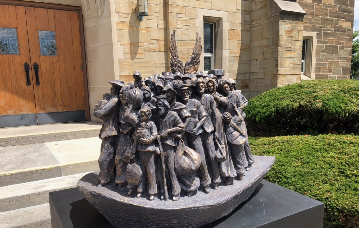 A resin model of a planned sculpture by artist Timothy P. Schmalz was unveiled Wednesday at St. Benedict Church in Eggertsville.