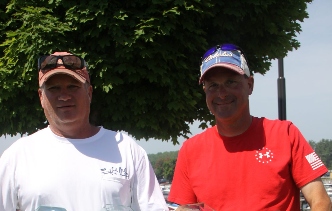 Grand Champion Angler at the CF Celebrity Tournament and captain to the Grand Champion were Mark Jacobs of Eden, left, and Capt. Chris Cinelli of Grand Island.