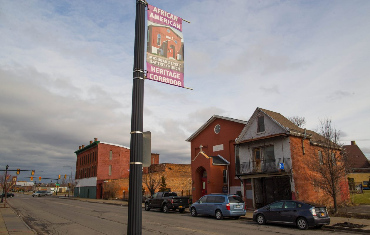 A banner hanging on Michigan Avenue across from the Michigan Street Baptist Church denotes the Michigan Avenue African American Heritage Corridor.  (Derek Gee/News file photo)