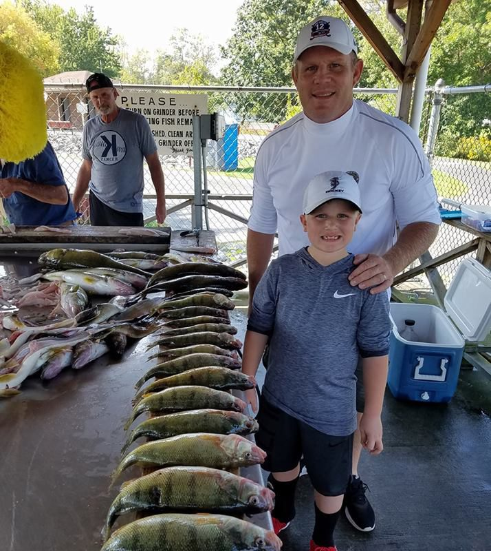 Rob Ray with his 9 year old son Robert enjoy the fishing resources we have here on a regular basis. Here they are together after a decent perch day on Lake Erie.