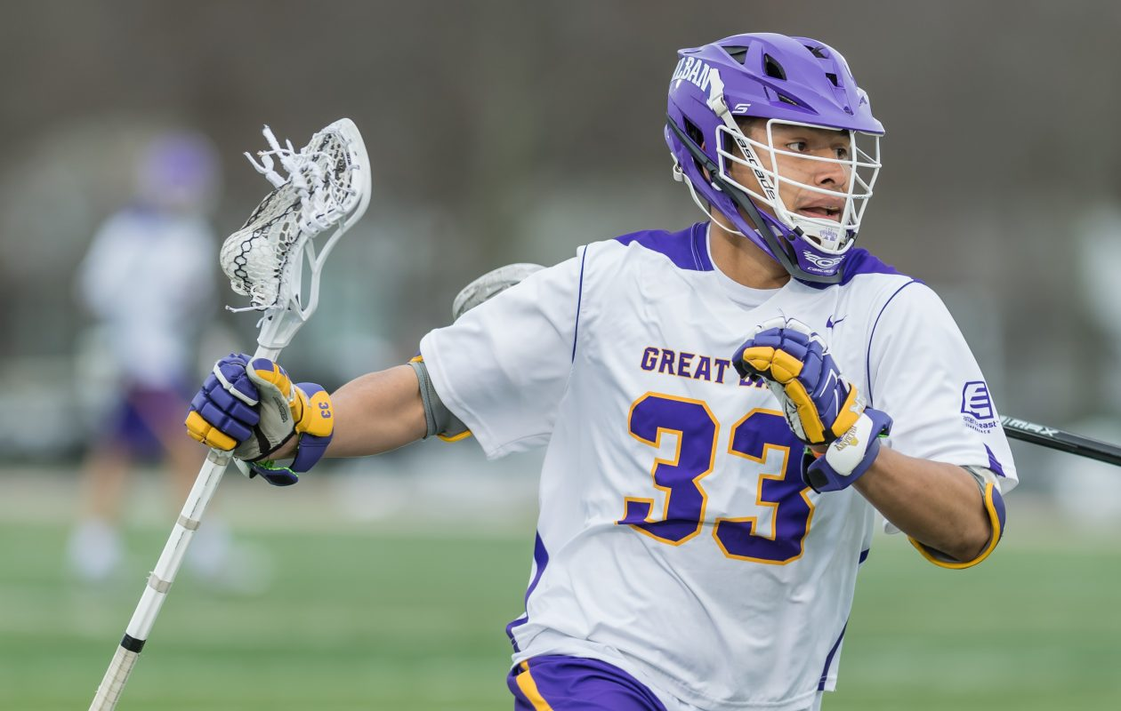 University at Albany Great Danes lacrosse player Ron John carries the ball against Drexel. (Photo courtesy of Bill Ziskin/UAlbany Athletics)