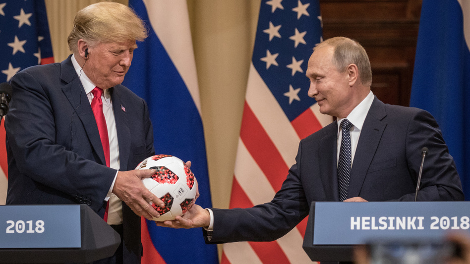 Russian President Vladimir Putin hands President Trump a World Cup soccer ball during a joint news conference after their summit. (Getty Images)