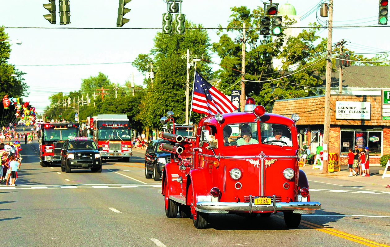 A Hutchinson Hose fire truck  during the Old Home Days Parade in Williamsville in 2012.  {Harry Scull Jr. / Buffalo News file photo}
