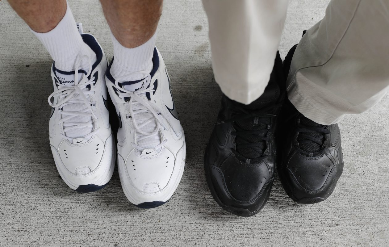 A friendship based on mismatched feet: Peter Talty, left, and Jim McCormick, right, who have two different shoe sizes, 9s and 13s, that become mirror images of each other, allowing them for years to buy shoes together - with none going to waste. (Mark Mulville/Buffalo News)
