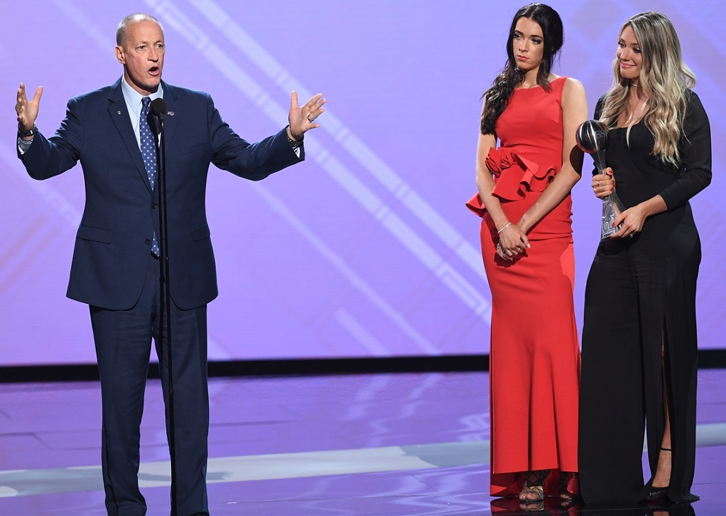 Bills Hall of Fame quarterback Jim Kelly accepts the Jimmy V award at the ESPYs, with daughters Erin, right, and Camryn. (Getty Images)