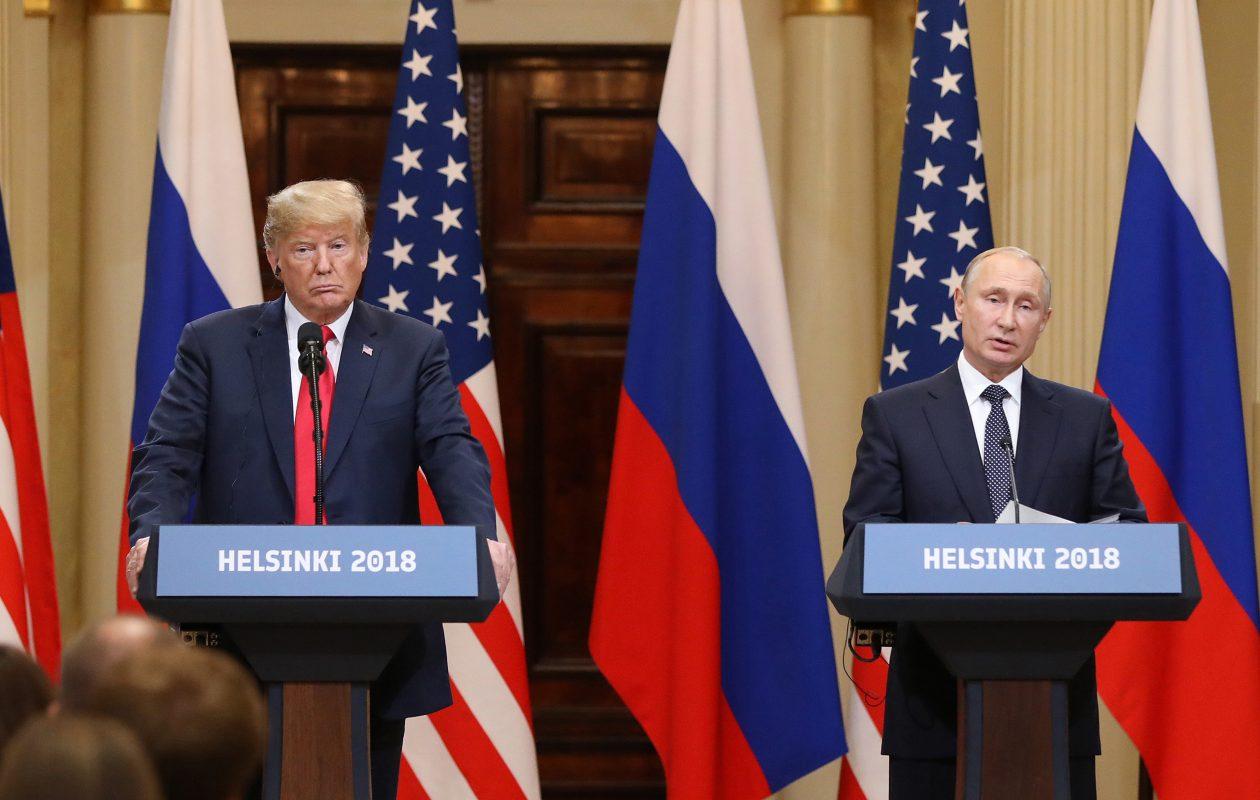 President Donald Trump, left, listens as Vladimir Putin, Russia's president, speaks during a news conference in Helsinki, Finland, on July 16, 2018.  (Bloomberg photo by Chris Ratcliffe)