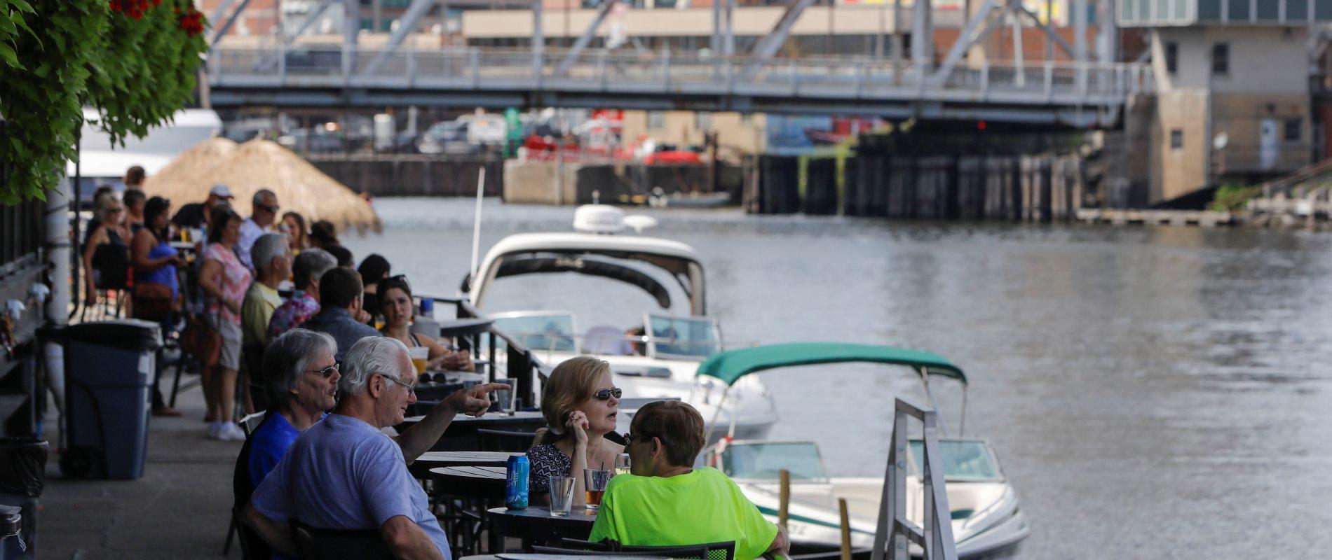 Diners enjoy the patio lining the Buffalo River at Buffalo RiverWorks. (Derek Gee/Buffalo News)