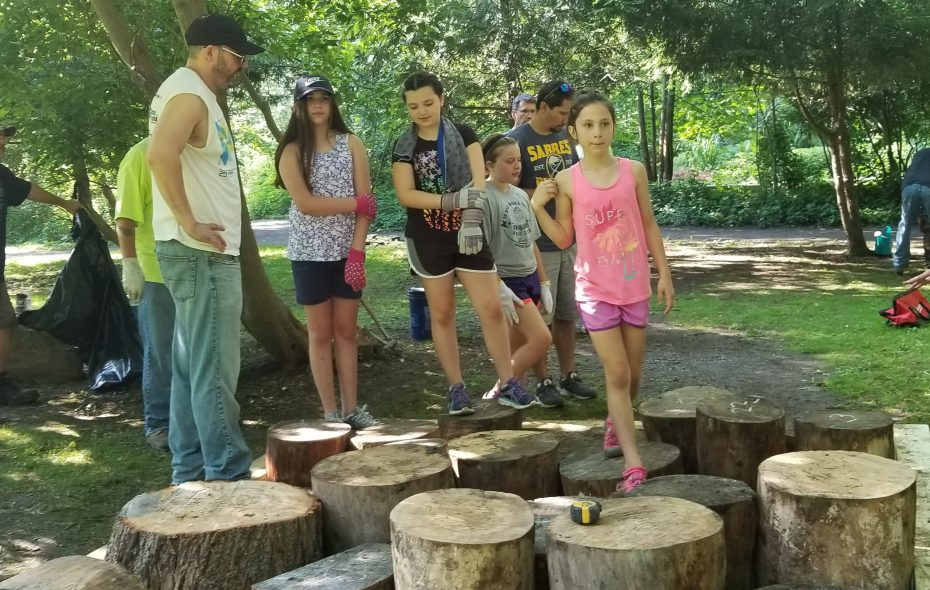 "Members of Girls Scout Troop 31024 and their families put together a ""stump garden"" at Burchfield Nature and Art Center in West Seneca. (Courtesy Burchfield Nature and Art Center)"