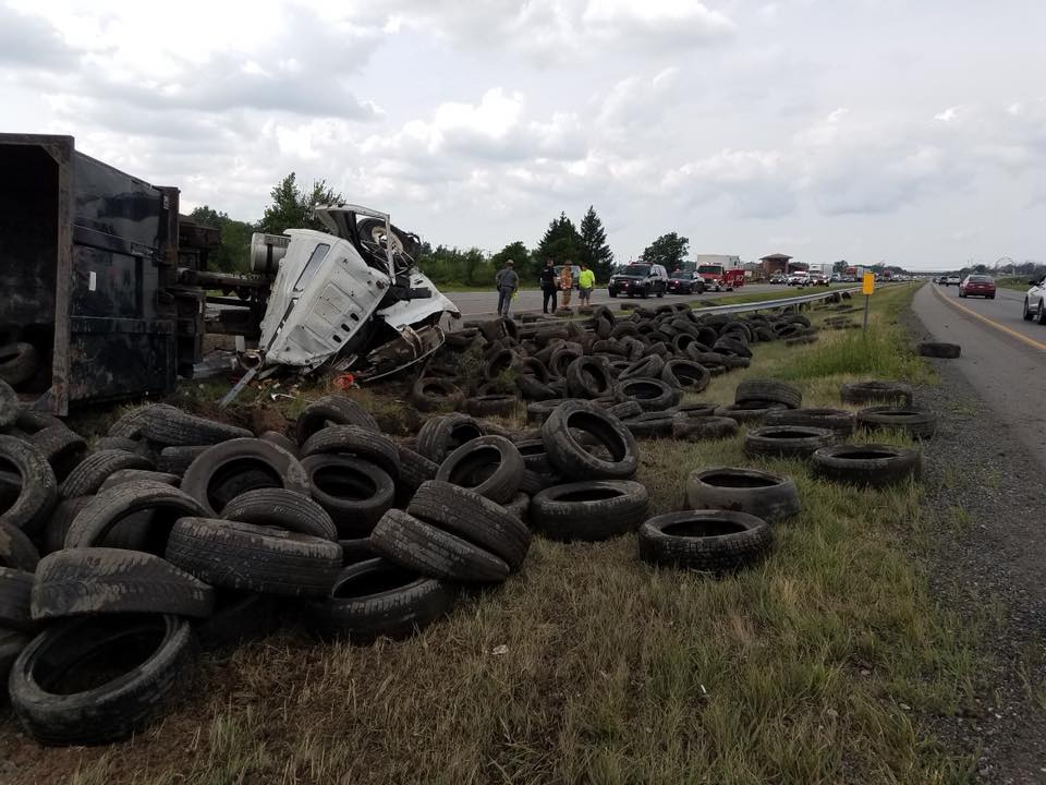 The scene Tuesday on the Niagara Thruway on Grand Island after a dump truck blew a tire, overturned and dumped its load of tires. (Photo provided by Grand Island Fire Company)