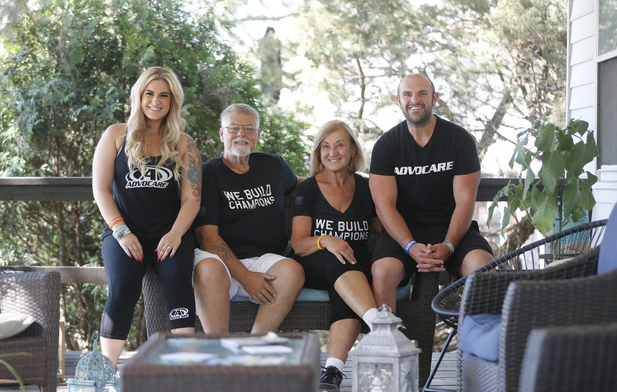 Sarah Bentley, her parents, Steve and Debbie Hoffman, and her husband, David, have each lost at least 100 pounds since early 2014 - and kept it off.   (Mark Mulville/Buffalo News)