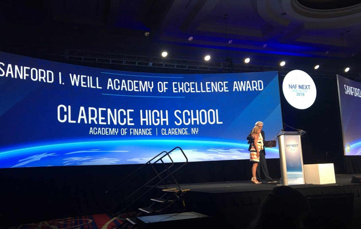 Heather Hartmann accepts the Weill Award on behalf of the Clarence High School academy. (Photo courtesy of Krissy Lawrence)