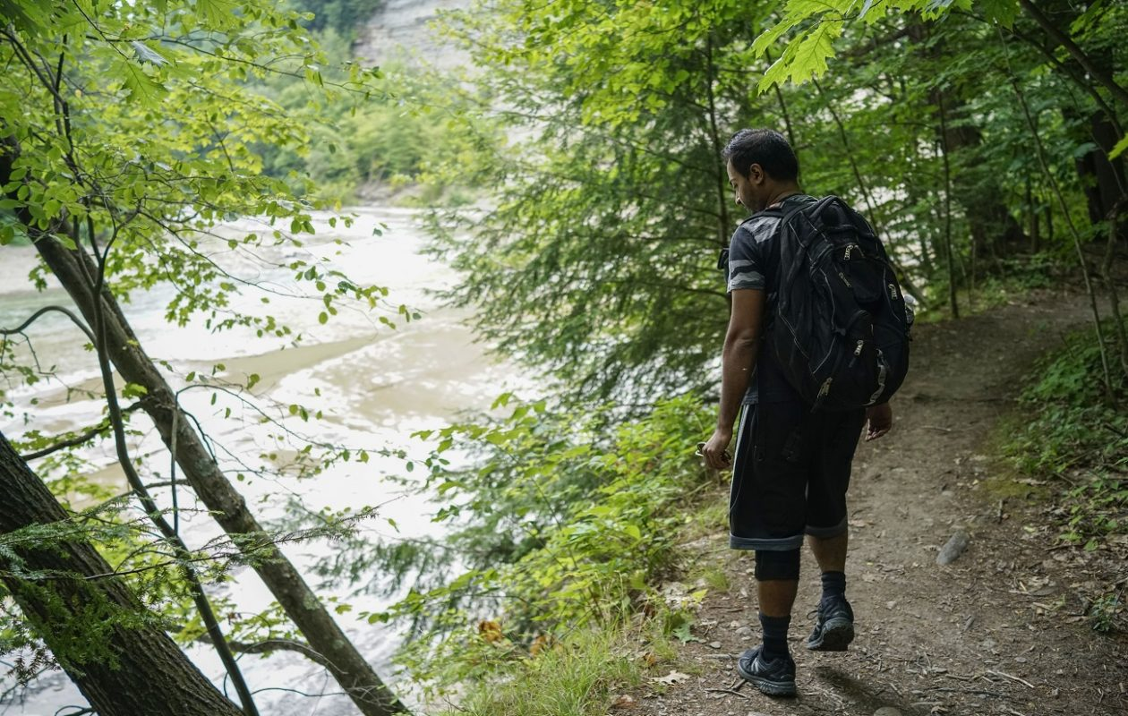 Tanseem Shah, 33, of East Amherst, hikes on the trail in the Zoar Valley Multiple Use Area on Monday, July 30, 2018. (Derek Gee/Buffalo News)
