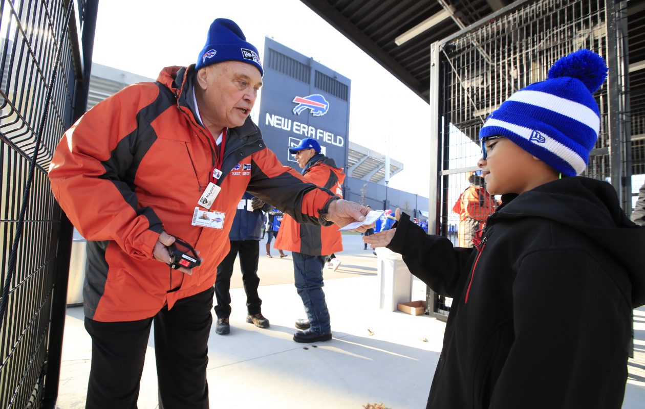 Maynard Bunn Jr scans the ticket of Enrique Ketavongsa, 7, attending his first Buffalo Bills game ever against the New England Patriots at New Era Field on Sunday, Dec. 3, 2017. (Harry Scull Jr./ Buffalo News)
