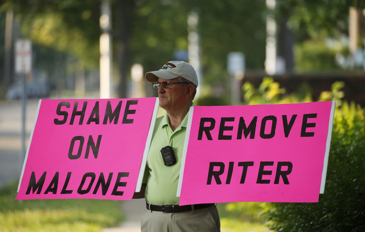Robert Hoatson of West Orange, N.J. protests outside of St. Elizabeth Ann Seton Catholic Church in Dunkirk before on July 1. The Rev. Dennis Riter was exonerated of claims of abuse and returned to his post as pastor after an investigation by the diocese found the claims 'were not substantiated.' (Derek Gee/Buffalo News)