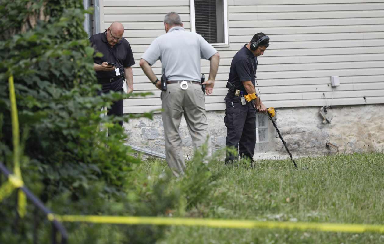Buffalo Police look for evidence in a field on Grape Street and Best after an overnight shooting took two lives, including a 17-month-old, in July 2. (Derek Gee/News file photo)