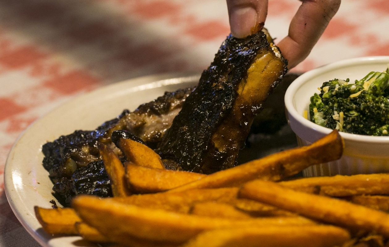 A plate of ribs, french fries and broccoli from BW's Smokin' Barrels Barbecue. (Shuran Huang/Buffalo News)