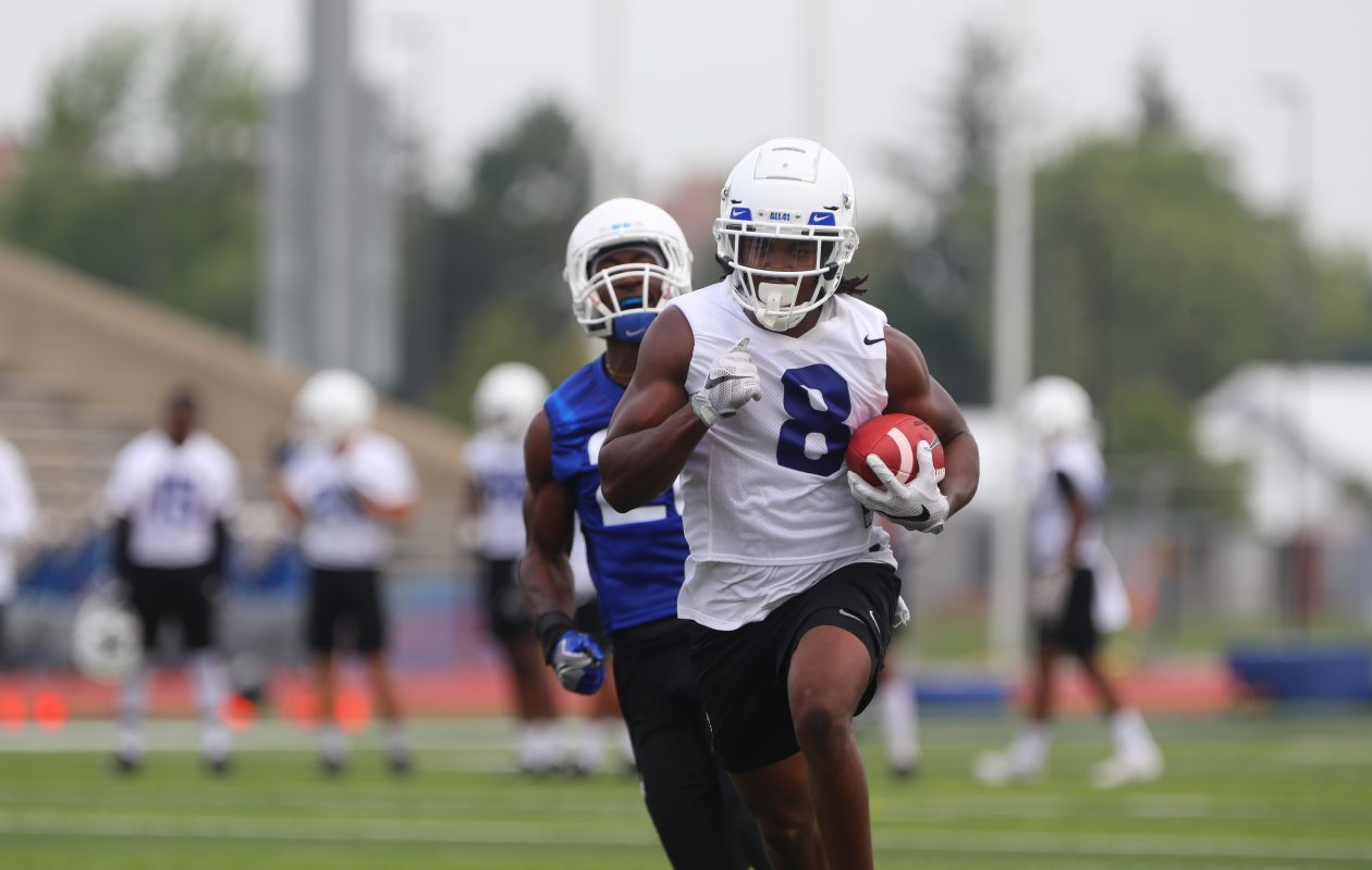 University at Buffalo wide receiver K.J. Osbourne hauls in a pass and runs with it on the first day of fall football practice at Alumni Stadium. (John Hickey/Buffalo News)