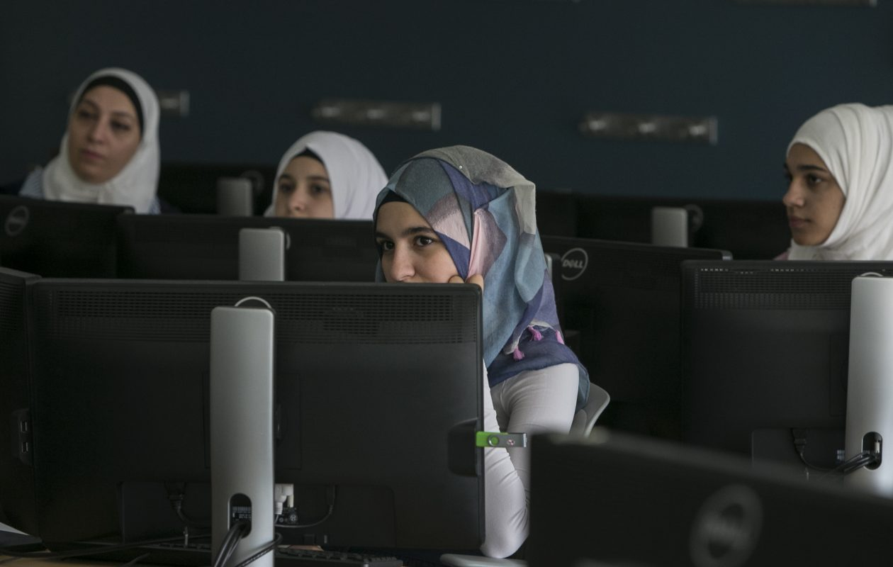 AT&T Coding Your Future program, supported by Journey's End Refugee Services, provides new immigrant teen girls with computer coding studies to help to close the tech gender gap. (Shuran Huang/Buffalo News)