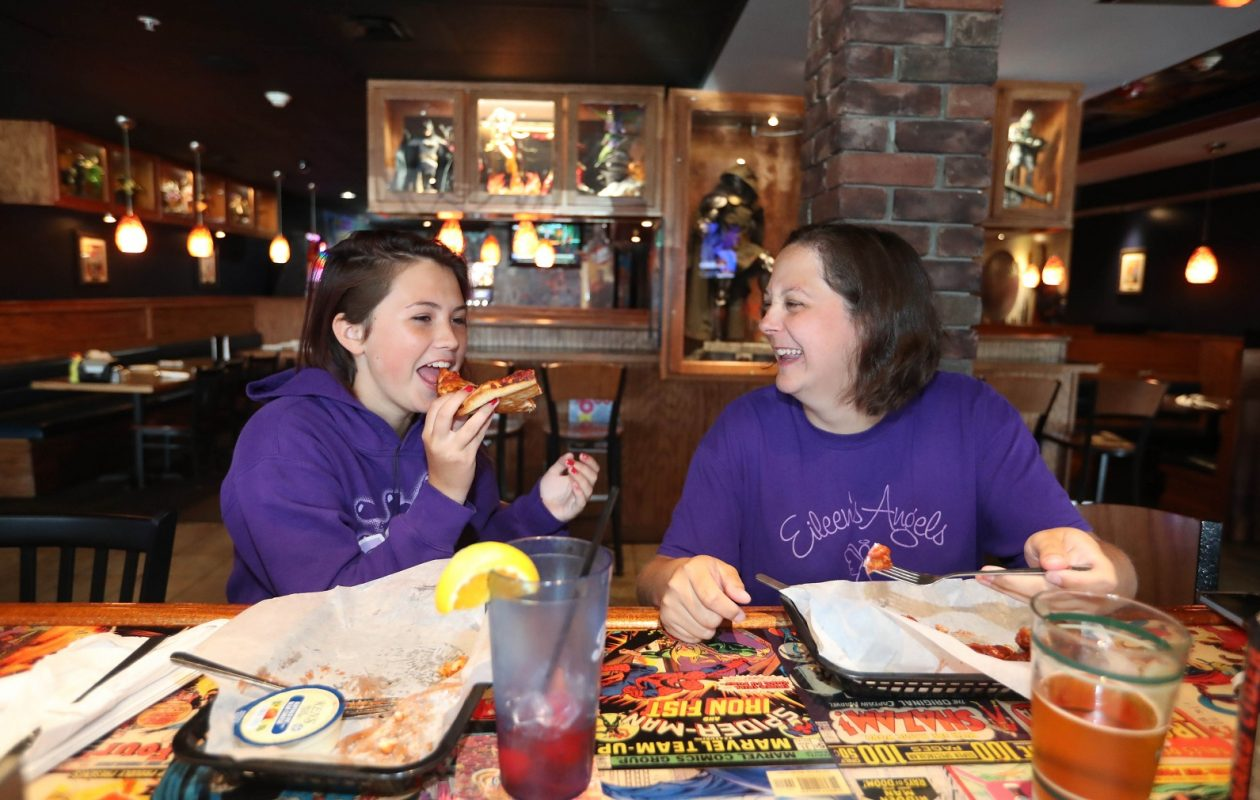 Zoe Wallace, 14, and her mother Melissa Williams, of Grand Island, have lunch at Say Cheese Pizza Co./The Comic Book Cafe. (Sharon Cantillon/Buffalo News)