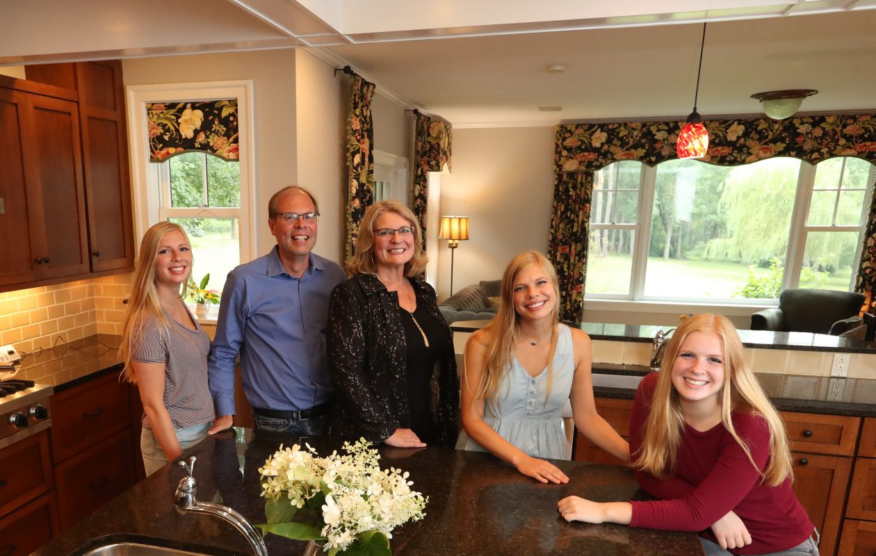 The Tapani family gathers at the kitchen island. From left: Eva, 19; Arno and Susan; Holly, 21, and Grace, 16. (Sharon Cantillon/Buffalo News)