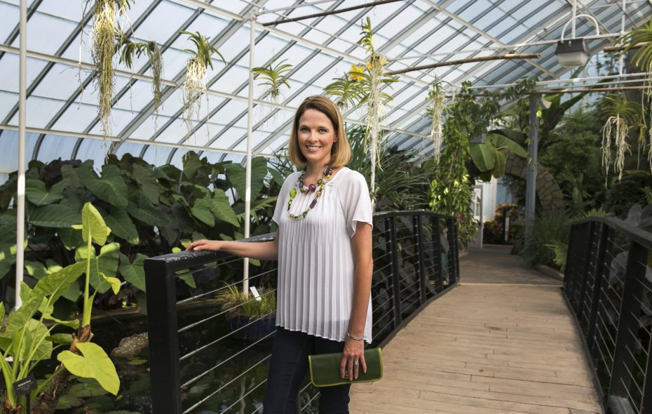 Erin Grajek, associate vice president of marketing and visitor experience, wears a favorite outfit for a photograph inside the Aquatic Garden and Asian Rainforest at the Buffalo and Erie County Botanical Gardens. (Shuran Huang/Buffalo News)